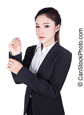 business woman in black suit is dressing up isolated on...