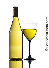 White wine - Glass and bottle of white wine on a reflective...