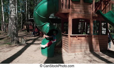 Happy kids playing and jumping passionately on a children's attraction