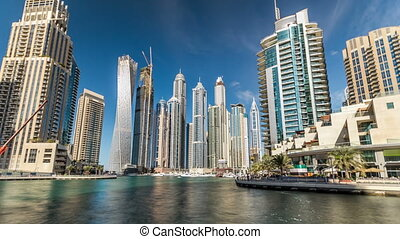 View of Dubai Marina Towers in Dubai at day time timelapse...