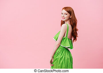 Smiling woman looking camera - Pretty woman wearing green...