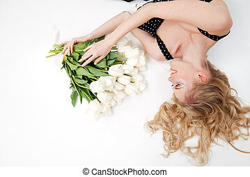 Top view of woman lying on floor with flowers