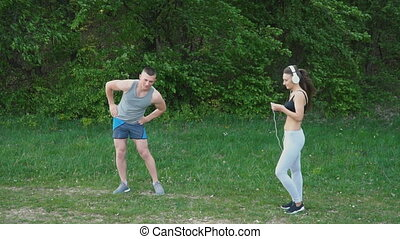 The guy does the warm-up while the girl is wearing...