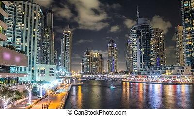 View of Dubai Marina Towers and canal in Dubai night...