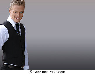 Smiling businessman - Attractive smiling young businessman...