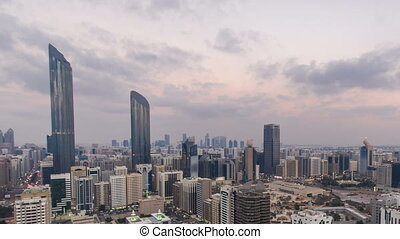 Modern city architecture of Abu Dhabi skyline day to night...