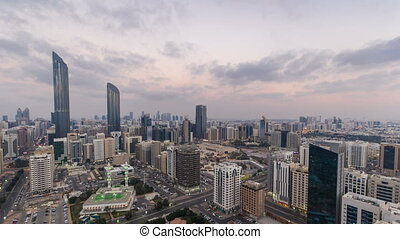 Modern city architecture of Abu Dhabi skyline day to night...