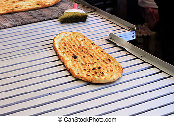 Fresh baked flatbread - Freshly baked flatbread, hot out of...