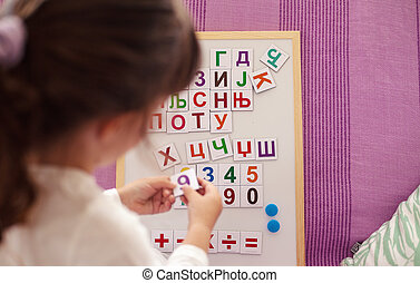 Learning Cyrillic Letters - Small girl is learning Cyrillic...