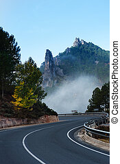 Road near Riopar, Albacete, with fog in the autumnal...