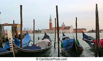 Parked gondolas sway on the waves in Venice - Venice,...
