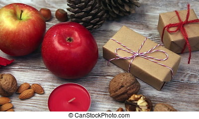Fresh apples, nuts and gift box