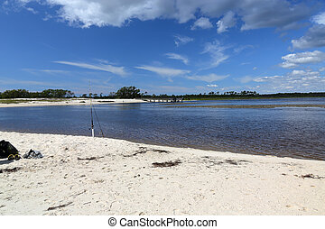 Cove with a sandy beach on the Florida Gulf Coast with blue...