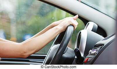 woman driving her car - Summer road trip, travel freedom...