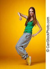 hip-hop girl - young woman - rnb dancer on yellow background
