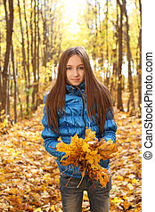 Young teenager girl in the autumn forest - Young teenager...
