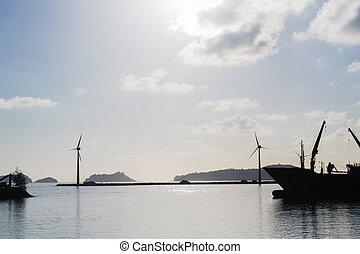 turbines at wind farm on sea shore
