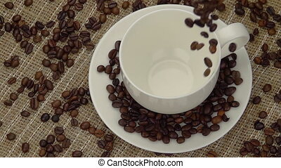 Whole Coffee Beans  Falling into the Cup.