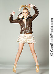 fashion woman jumping - studio fashion style photo of young...