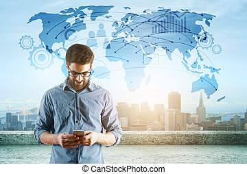 Travel concept - Young businessman using cellphone while...