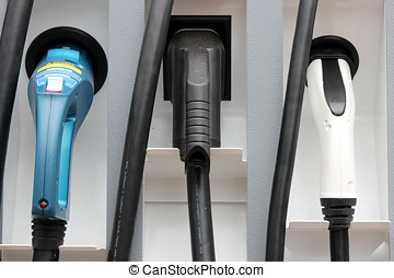 electric vehicle charging station - plugs at electric...