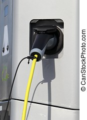 electric vehicle charging station - plug at electric vehicle...