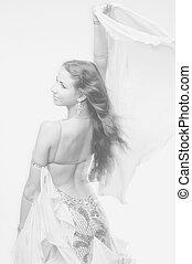 dancing woman - monochrome studio photo of young beautiful...