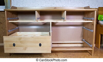 assembly of furniture dresser,Time lapse, - assembly of...