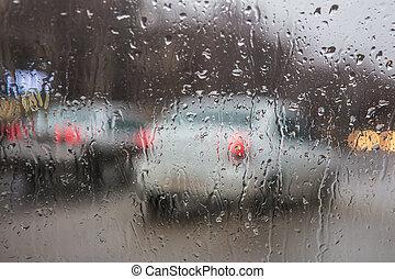 street through rain drops - view of the street through rain...