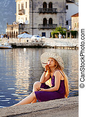 Beautiful woman relaxing by the sea in Montenegro