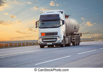 fuel truck on the highway - big fuel truck goes on the...