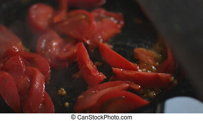 Tomatoes roasting in the pan - Close up shot of large pieces...