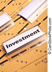 investment word on business folder showing financial success...