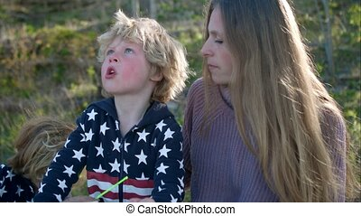 The boy shows his mother the sky.