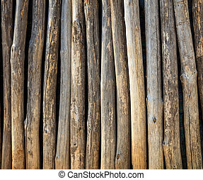Wooden tree trunks fence background
