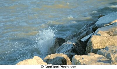 The waves beat against the rocks.
