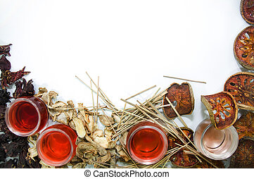Tea and herbs - Tea in small glass cups surrounded by dried...