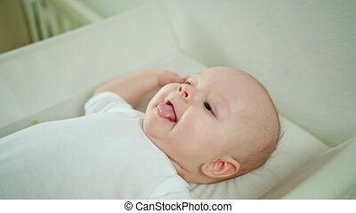 Baby Lying in Bed at Home and Playing - Baby's playing...
