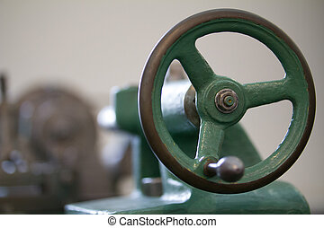 Handle of antique lathe, blurred - Blurred, Image of green...