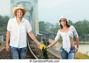 Couple on train tracks - Young couple posing on a train...