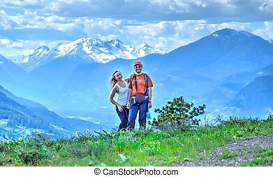 Friends walking on meadows in North Cascades National Park....