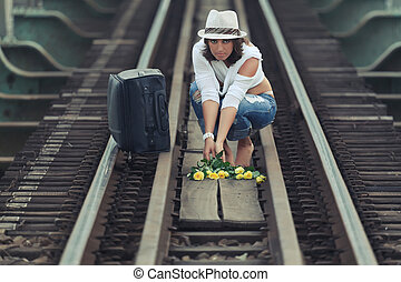 Woman on train track