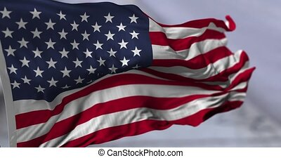 Flag of USA blowing on the wind, close up looped slowmotion,...