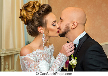 Just merried couple in love kissing