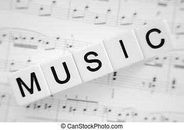Music - Word music with black letters on white tiles and...