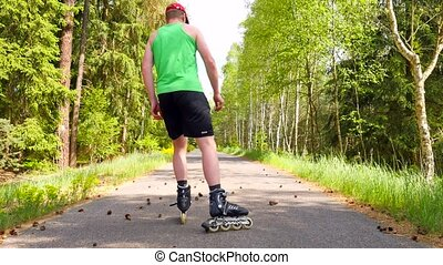 Rear view to inline skater in green running singlet ....