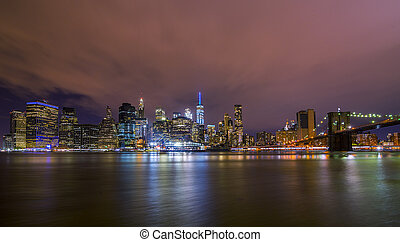 Downtown Manhatten Skyline at Night - New York City...