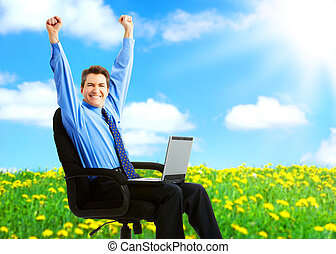 happy businessman - Successful happy businessman with laptop...