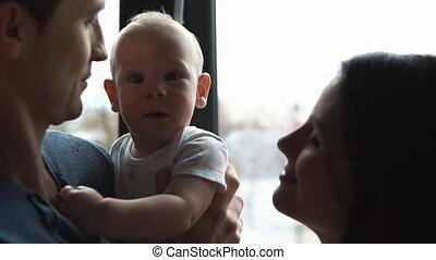 Little child with tender hands on man's shoulder.