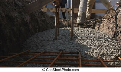 Concrete is flowing through the trench - Above view on...